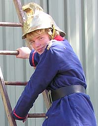 Fireman Alex in an 1890s fireman's uniform