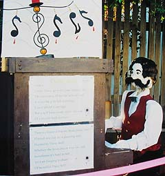 A piano playing scarecrow